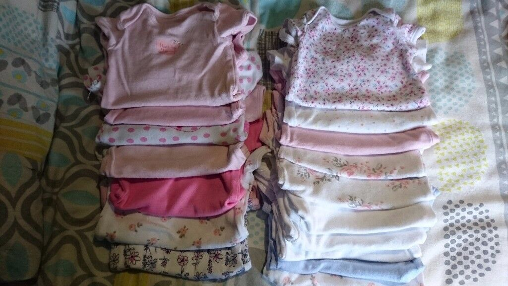 Bundle of baby girl sleepsuits and vests