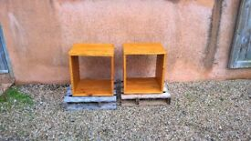 A pair of tall bedside cube tables Ex display