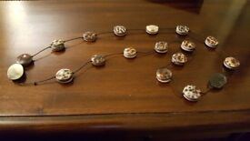 Necklace with round tortoiseshell effect beads and brown cord in between.