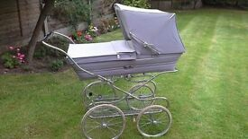 Silver Cross Baby's pram grey very good condition Easy to push and manouver.