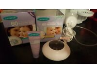 Electric Tommi Tipee breast pump with lanolin and breast pads