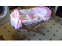 Moses basket with pine stand.