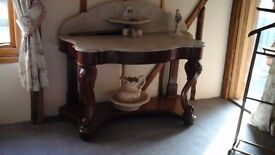 A washstand with grey marble top