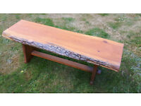 Original wooden bench which includes the edge of the tree bark