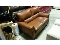 Tan leather 2 x 2 seater sofa with pouffe