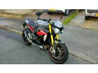 Triumph Speed Triple R, packed full full of accessories. Scorpion exhaust