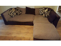 Corner sofa with footstool and cushions