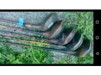 5 wooden golf clubs