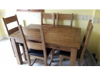 Extendable Oak Dinning room table and 6 chairs