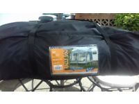 kampa 260 porch awning, comes with ground sheet,pegs and caravan skirt all in good condition.