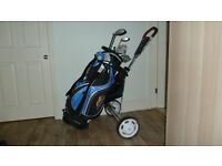 Clubs in a PowaKaddy bag and Proline trolley