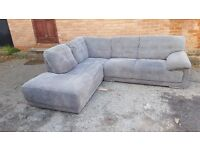 Comfy Ex Display model grey fabric corner sofa. few minor marks around. less the half price.deliver