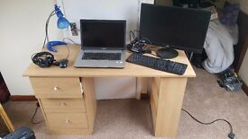 3 draw office desk with leather chair, samsung laptop with extra monitor key board and mouse.