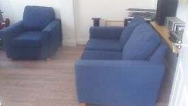 Blue 2 seater sofa and armchair.