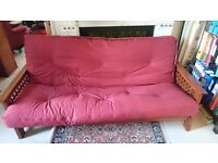 Akino 3-seater bi-fold sofabed futon in burgundy in excellent condition