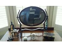 Dressing table, mirror and chair.