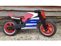 Kiddimoto wooden balance bike.