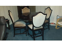 Round / Oval Extending Dining Table and 4 Upholstered High Back Chairs.