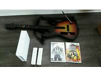 Nintendo wii console 2 x controllers plus guitar hero