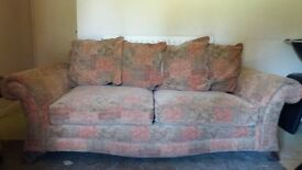 Three seater sofa multi coloured good condition 970mm x 2000mm. Can deliver