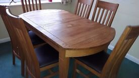 Barker and Stonehouse solid oak dining table and 6 matching chairs