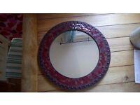 Circular mirror with mosaic frame.