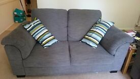 2 seater grey sofa in perfect condition.