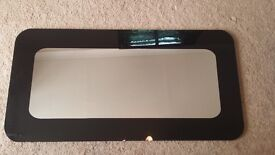 Black edged curved mirror. 121x61cm. Vertical or horizontal. Perfect condition