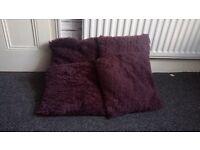 4 fluffy purple/burgundy cushions