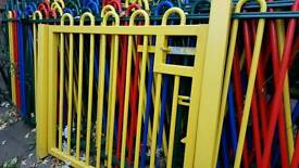 Metal fencing with a strong solid gate