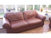2 Brown Leather Sofas.