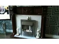 Electric fire and solid oak surrounding