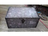 small wooden covered storage trunk
