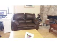 Two seater brown leather sofa - In excellent condition. Delivery can be arranged