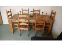 Hard wood dining table with 6 chairs,6feet by 3feet