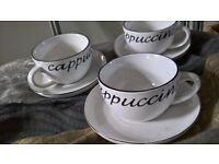 six cappuccino cups & saucers