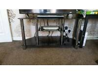Glass T.V Table/stand. black in colour with silver stand