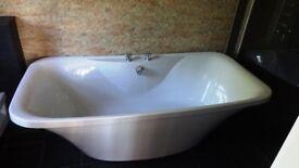 Large freestanding bath + taps/waste
