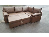 Lovely Brand New brown faux leather corner sofa bed with storage.small mark. can deliver