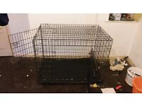 A large dog cage for sale