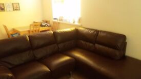 Large, right hand leather sofa.
