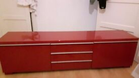 Bright red tv cabinet from ikea