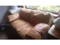 3 and 2 seat buttery soft tan leather sofas from Reid furnishings