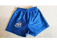 Newcastle United shorts - childs size 104cm