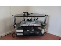 TV / Video / DVD stand in glass and chrome. As new.