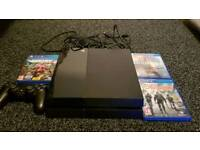 PlayStation 4 with games and Mint condition V2 Dualshock 4