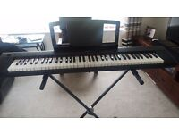 YAMAHA PIAGERRO NP31 KEYBOARD 76 keys incl stand, carry case, headphones & sustain pedal.