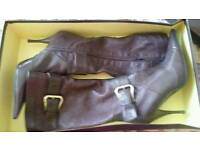 Ladies heel leather boots size 4