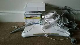 Nintendo Wii console games and fit board
