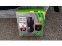 Xbox 360 250gb (boxed) w/ 11 games.
